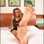 Fétichisme des pieds sexy avec du footjob en photos 42
